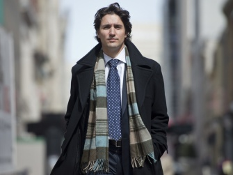 Liberal leadership candidate Justin Trudeau walks down the street after speaking with The Canadian Press, Thursday, April 11, 2013 in Ottawa. THE CANADIAN PRESS/Justin Tang