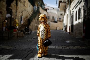 Ultra-orthodox Jewish boy wears a costume ahead of  Purim in Jerusalem's Mea Shearim neighbourhood